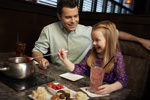 Dad and Daughter Share Fondue at The Melting Pot