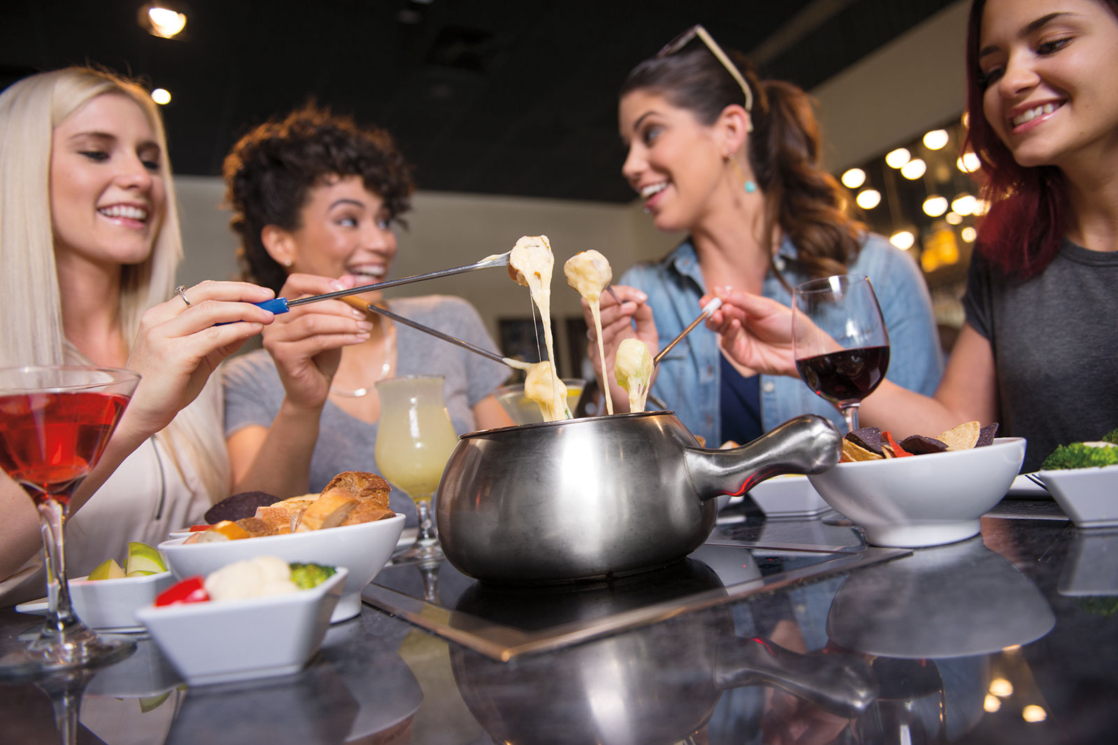 Three Women Having Fun at the Melting Pot Fondue Restaurant