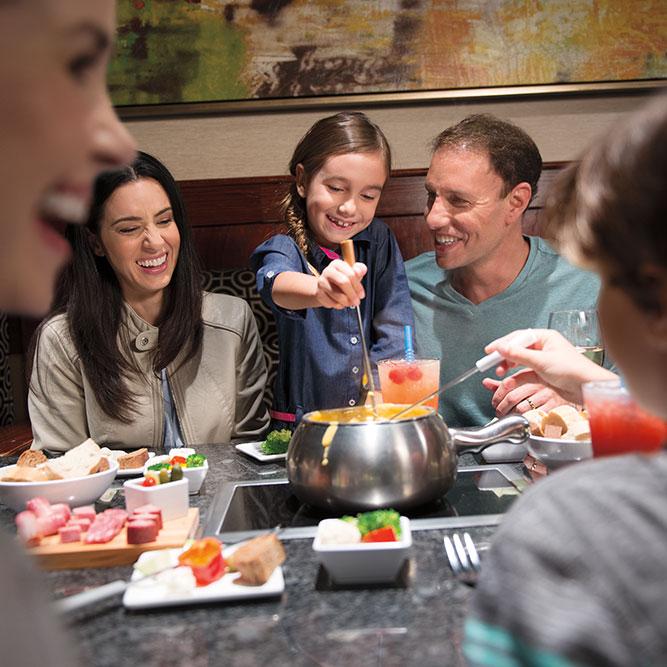Family enjoying fondue